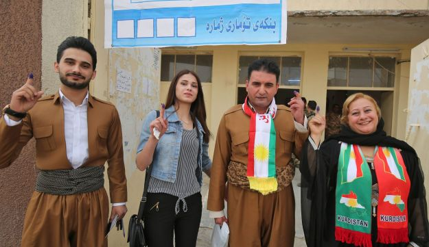 Iraqi Kurds show their ink-stained fingers after voting in the Kurdish independence referendum in the city of Kirkuk in northern Iraq, September 25, 2017.
