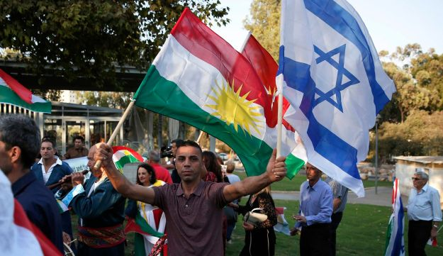 Members of the Kurdish Jewish community hold Kurdish and Israeli flags during a demonstration in Jerusalem on September 24, 2017.