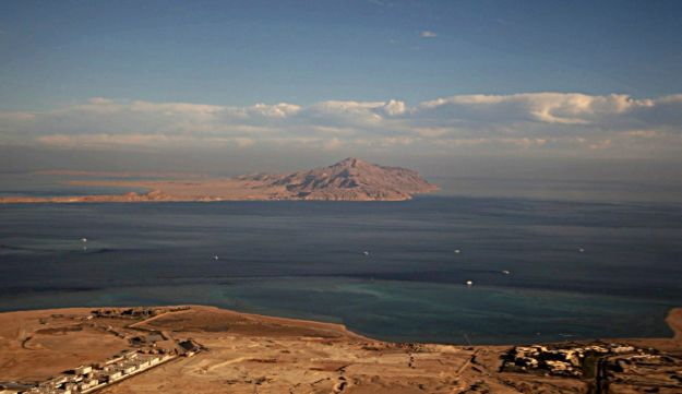 A file photo from 2014 shows the Red Sea's Tiran (foreground) and the Sanafir (background) islands in the Strait of Tiran between Egypt's Sinai Peninsula and Saudi Arabia.