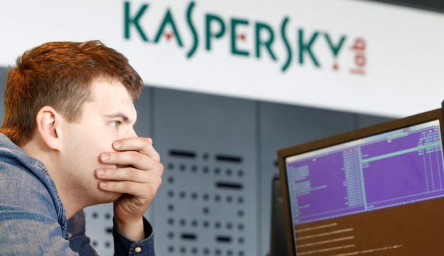 FILE PHOTO: An employee works near screens in the virus lab at the headquarters of Russian cyber security company Kaspersky Labs in Moscow July 29, 2013.