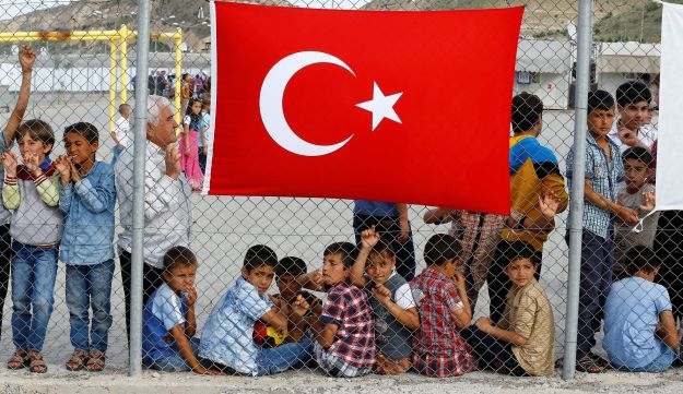 Refugees waiting for the arrival of officals at Nizip refugee camp near Gaziantep, Turkey, April 2016.