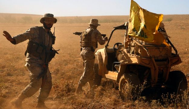 Hezbollah fighters at a site where clashes erupted between Hezbollah and Al-Qaida-linked fighters at the Lebanon-Syria border, July 29, 2017.