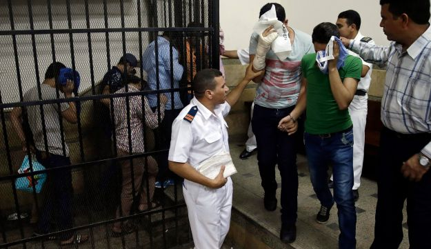 "FILE - In this Saturday, Nov. 1, 2014 file photo, eight Egyptian men convicted for ""inciting debauchery"""