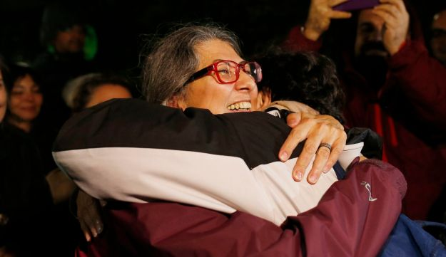 Activist Ozlem Dalkiran, centre, of the Citizens' Assembly organization, hugs a colleague after her release from Silivri prison outside Istanbul, early Thursday, Oct. 26, 2017
