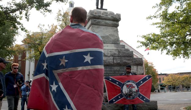 People hold Confederate flags during a White Lives Matter rally on October 28, 2017 in Murfreesboro, Tennessee.