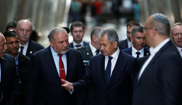 Russian Defense Minister Sergey Shoygu gestures as he walks with his Israeli counterpart Avigdor Lieberman during a visit to the Yad Vashem's Holocaust History Museum in Jerusalem, October 17, 2017.