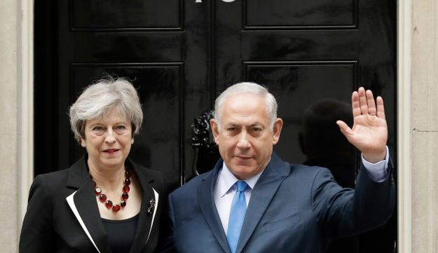 British Prime Minister Theresa May and Israeli Prime Minister Benjamin Netanyahu pose for the media as Netanyahu arrives for their meeting at 10 Downing Street in London, Thursday, Nov. 2, 2017. (AP Photo/Matt Dunham)