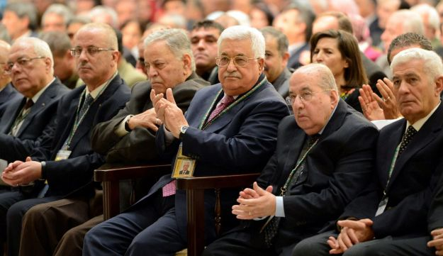 Palestinian President Mahmoud Abbas (3rd R) attends the opening session of Fatah congress in the West Bank city of Ramallah November 29, 2016.