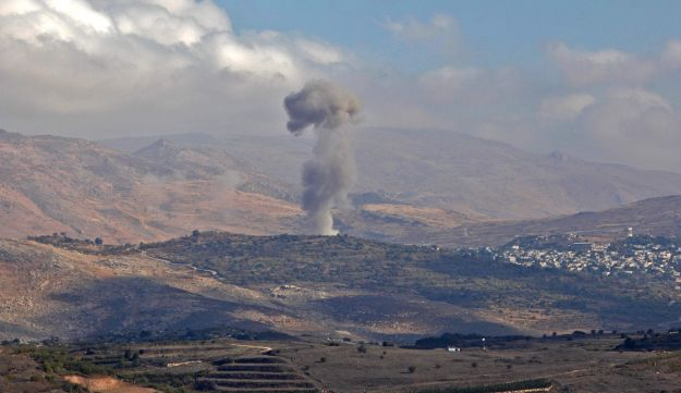 Smokes billows from the southern Syrian Druze village of Khadar on November 3, 2017 as seen from the Israeli-annexed Golan Heights.