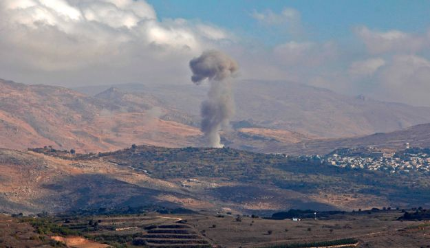 Smokes billows from the southern Syrian Druze village of Hadar on November 3, 2017.