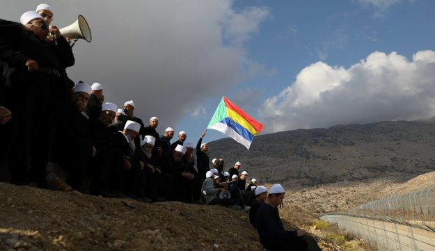 Members of the Druze community in Majdal Shams in the Israeli Golan Heightscommunicate with Syrian Druze friends and relatives on the other side of the border on November 4, 2017.