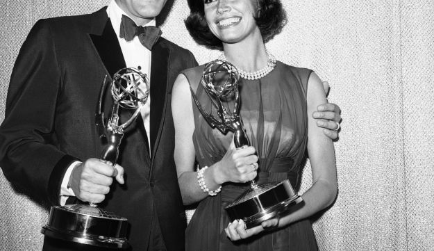 """FILE - This May 25, 1964 file photo shows Dick Van Dyke, left, and Mary Tyler Moore, co-stars of """"The Dick Van Dyke Show"""" backstage at the Palladium with their Emmys for best actor and actress in a series at the Television Academy's 16th annual awards show, in Los Angeles. Moore died Wednesday, Jan. 25, 2017, at age 80."""