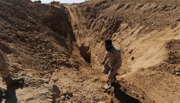 A member of Palestinian security forces searching for missing or dead militants after Israel blew up a cross-border tunnel, in Khan Younis, Gaza Strip November 3, 2017.