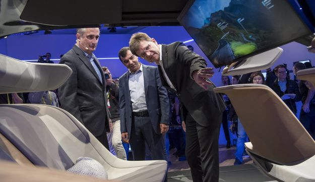 Brian Krzanich, chief executive officer of Intel Corp., from left, Amnon Shahua, chairman and chief technology officer of Mobileye, and Klaus Froehlich, member of the management board at Bayerische Motoren Werke AG (BMW), view the BMWi Inside Future concept vehicle during a press event at the 2017 Consumer Electronics Show (CES) in Las Vegas, Nevada, U.S., on Wednesday, Jan. 4, 2017. BMW AG will dispatch a fleet of autonomous vehicles to U.S. and European cities in this year's second half, the next step in its partnership with Mobileye NV and Intel Corp. to introduce fully self-driving vehicles by 2021. Photographer: David Paul Morris/Bloomberg