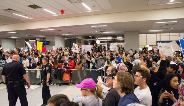 Demonstrators protesting against the Trump administration's new anti-Muslim travel restrictions at Dallas/Forth Worth Airport on Saturday.