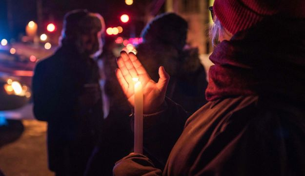 People show their support after a fatal shooting in a mosque in Quebec City, Canada, January 29, 2017.