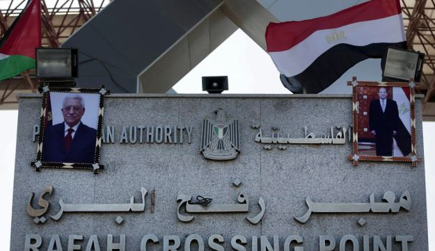 Palestinian and Egyptian flags wave over two photos of Palestinian President, Mahmoud Abbas, and Egypt's President Abdel-Fattah el-Sissi, hanging on the Rafah border crossing's main gate, Gaza. Nov. 1, 2017
