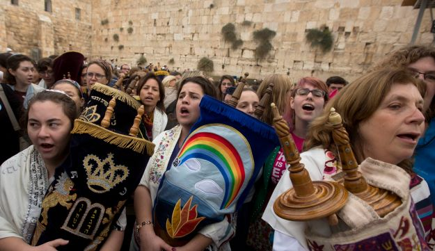 Women hold Torah scrolls as they pray at the Western Wall in Jerusalem's Old City, November 2, 2016.