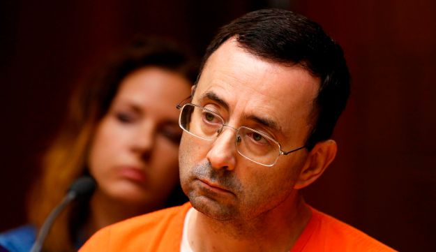 Former Michigan State University and USA Gymnastics doctor Larry Nassar being sentenced in a Michigan court to stand trial on 12 counts of first-degree criminal sexual conduct on June 23, 2017 shows.