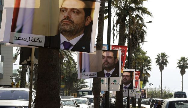 "Posters of Lebanese Prime Minister Saad Hariri with the caption ""#We_are_all_Saad"" hang in Beirut, November 10, 2017."