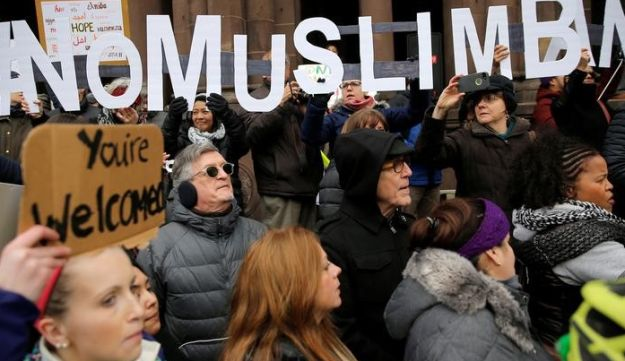 "Demonstrators spell out ""# No Muslim Ban"" during the ""Boston Protest Against Muslim Ban and Anti-Immigration Orders"" to protest U.S. President Donald Trump's executive order travel ban in Boston, Massachusetts, U.S. January 29, 2017."