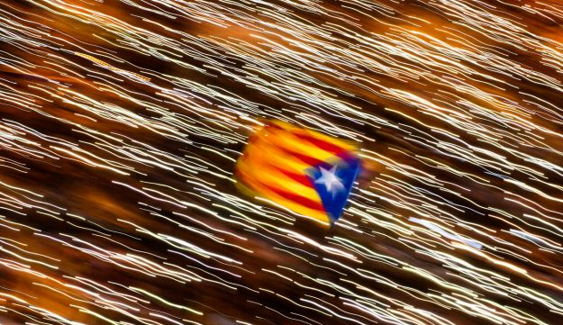 An independence flag is waved as demonstrators take part at a protest calling for the release of Catalan jailed politicians in Barcelona, Spain, November 11, 2017.
