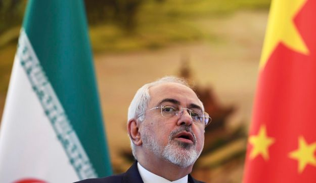 Iranian Foreign Minister Mohammad Javad Zarif speaks during a joint press conference with Chinese Foreign Minister Wang Yi in Beijing Monday, Dec. 5, 2016.