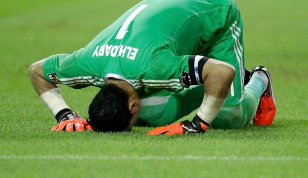 Egypt goalkeeper Essam El Hadary bows on the pitch after stopping a penalty shot from Burkina Faso in Libreville, Gabon, February 1, 2017.
