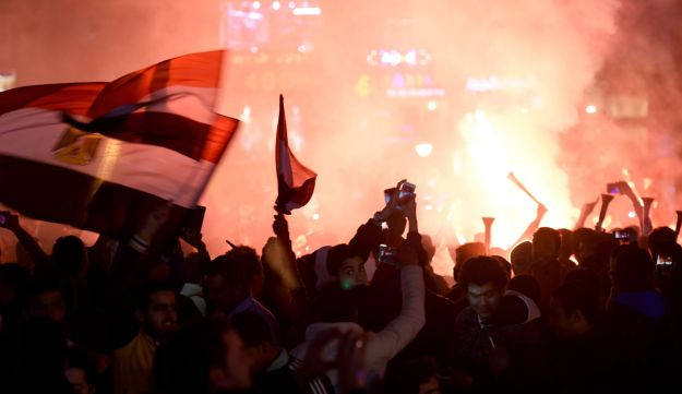 Egyptian fans celebrate after the 2017 Africa Cup of Nations semi-final football match in Cairo on February 1, 2017.