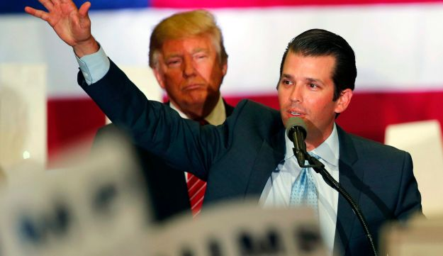 Then-Republican presidential candidate Donald Trump listens as his son Donald Trump Jr., foreground, speaks at a campaign rally in New Orleans, March 4, 2016.