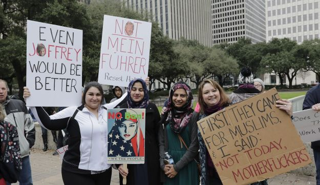 Marchers protesting against President Donald Trump, in Houston, Texas, February 4, 2017