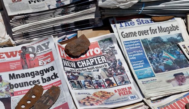 Newspapers at a news stand in Harare, Zimbabwe Monday, Nov. 20, 2017