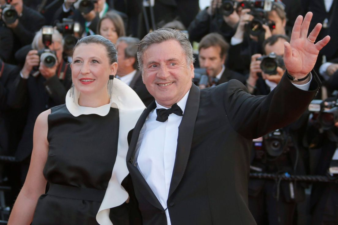Jury member, actor Daniel Auteuil, waves as he arrives with his wife for  the screening of Venus in Fur at the 66th international film festival, in  Cannes, ...