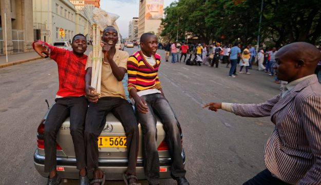People rejoice in the streets following Mugabe's resignation