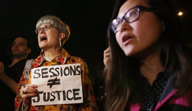 Protesters demonstrate outside the house of Senate Majority Leader Mitch McConnell ahead of the Senate vote to confirm Sen. Jeff Sessions as attorney general on February 8, 2017 in Washington, D.C.