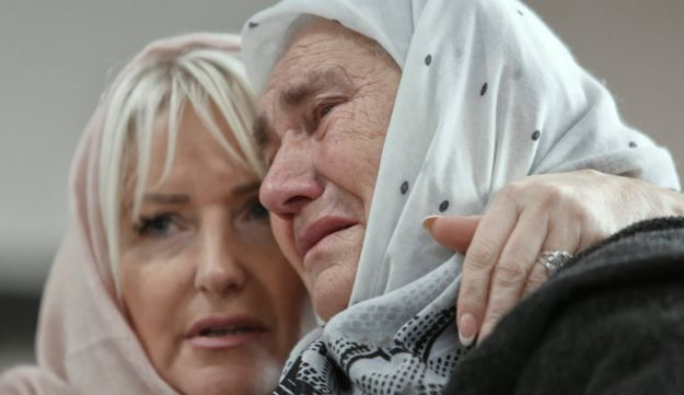 Bosnian women are overwhelmed by emotion watching the final moments of former Bosnian Serb military chief Gen. Ratko Mladic's trial, near Srebrenica, Bosnia, November 22, 2017.