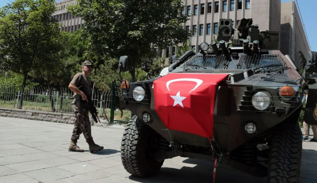 Turkish security officers stand next to an APC outside a courthouse in Ankara, Turkey on July 18, 2016.
