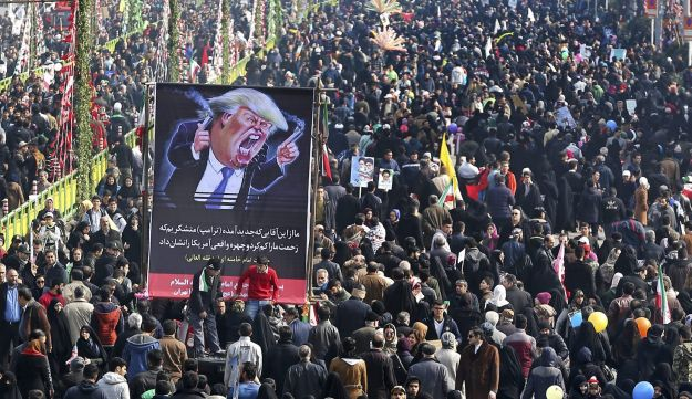 Iranians carry a banner showing a caricature of Trump during rally on the anniversary of the 1979 Islamic revolution in Tehran, Iran, Feb. 10, 2017.