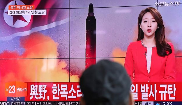 A man watches a program reporting about North Korea's missile launch, Seoul, South Korea, February 12, 2017.