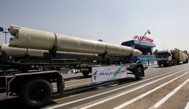 FILE - In this Friday, Sept. 21, 2012 file photo, a Qiam missile is displayed by Iran's Revolutionary Guard during a military parade