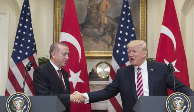"U.S. President Donald Trump, right, shakes hands with Recep Tayyip Erdogan, Turkey's president, during a news conference at the Roosevelt Room of the White House in Washington, D.C., U.S., on Tuesday, May 16, 2017. Erdogan said he's looking forward to a ""decisive meeting"" with his U.S. counterpart Trump, whose decision to arm Kurdish groups against Islamic State in Syria has stoked tensions between the two NATO members. Photographer: Michael Reynolds/Pool via Bloomberg"