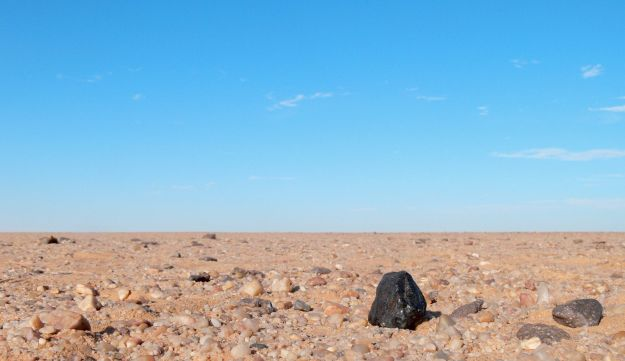 This December 2008 photo, released by NASA, shows a black chunk of rock found in the Sudan desert, the first time astronomers have tracked an asteroid from space, toward Earth, into the atmosphere and down on the ground as a meteorite.