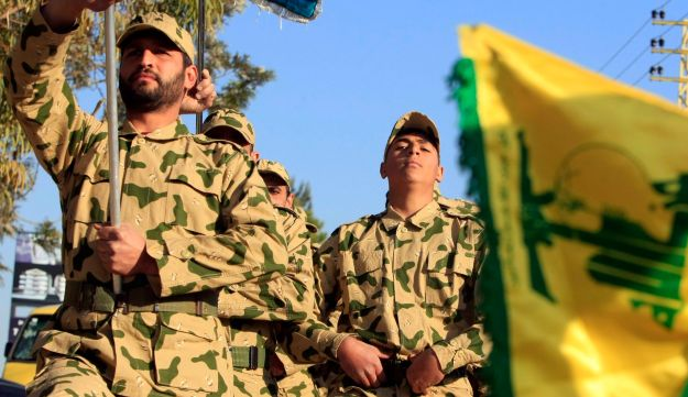 Hezbollah fighters parade during a ceremony to honor fallen comrades, in Tefahta village, south Lebanon, Saturday, Feb. 18, 2017.