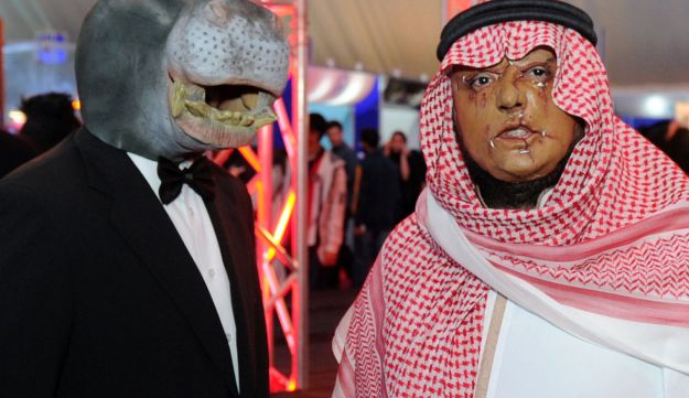 Two persons are wearing masks as they take part in Comic Con expo in Jeddah, Saudi Arabia February 18, 2017.