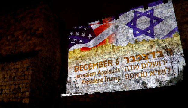 A giant U.S. flag screened alongside Israel's national flag by the Jerusalem municipality on the walls of the Old City. December 6, 2017