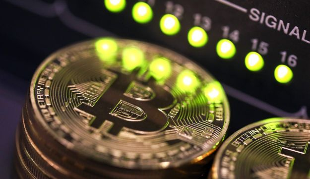 FILE: Stacks of bitcoins sit near green lights on a data cable terminal inside a communications room at an office in this arranged photograph in London, U.K., on Tuesday, Sept. 5, 2017.