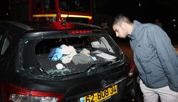 A car that sustained damage as the result of a rocket fired from the Gaza Strip, Sderot, southern Israel, December 9, 2017.