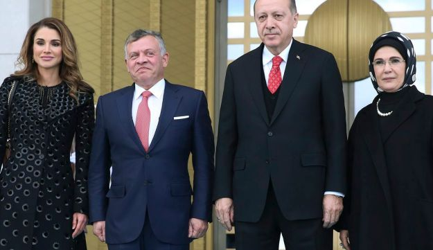 Turkey's President Recep Tayyip Erdogan, 2nd right, accompanied by his wife Emine, right, pwith Jordan's King Abdullah II, 2nd left and his wife Queen Rania, left, in Ankara, Turkey, Wednesday, Dec. 6, 2017