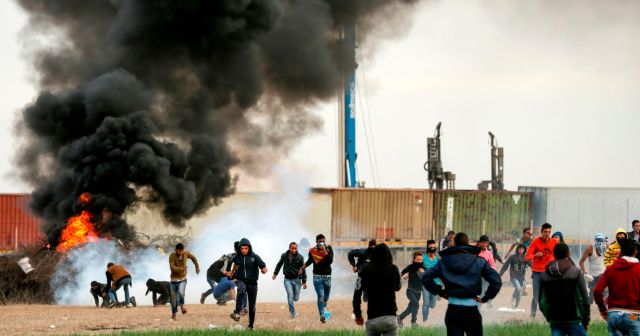 Palestinian protesters clashing with Israeli forces near the Israel-Gaza border, east of the southern Gaza strip city of Khan Yunis, December 10, 2017.