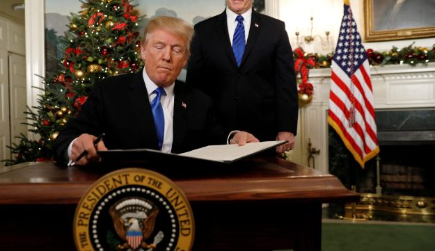 U.S. Vice President Mike Pence stands by as U.S. President Donald Trump signs a proclamation recognizing Jerusalem as the capital of Israel during an address from the White House in Washington on December 6, 2017.